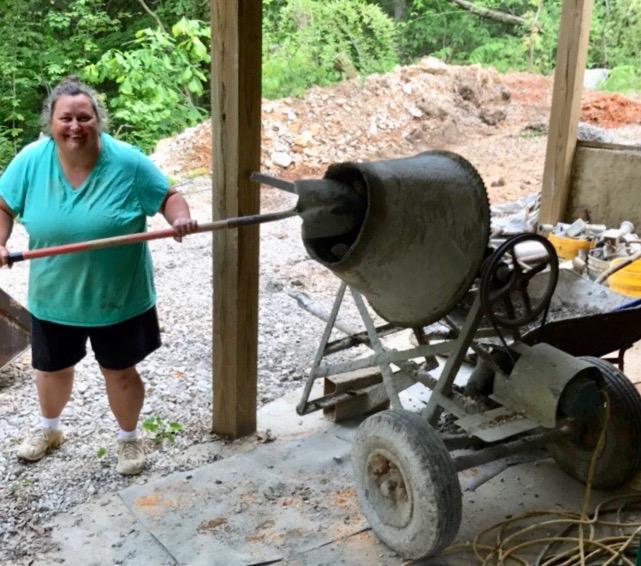 Sara mixing concrete